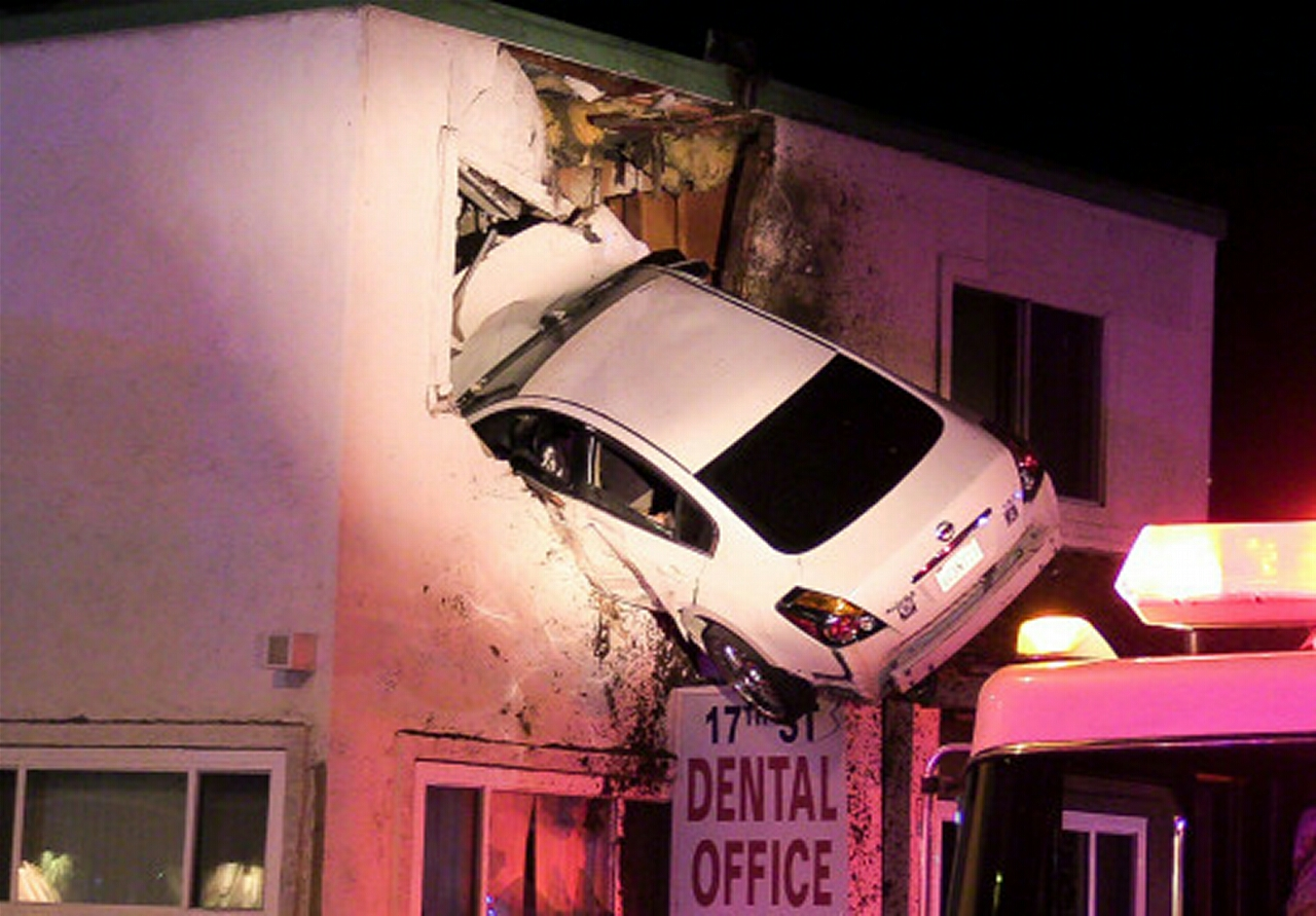 Speeding Car Hits Median, Goes Airborne and Crashes Into 2nd Floor of Building