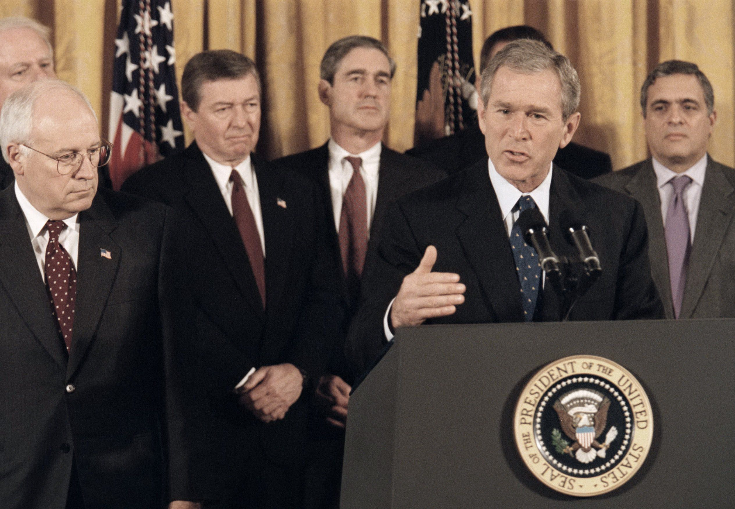 WASHINGTON, DC - OCTOBER 26 - President George Bush delivers speech before signing Patriot Act Anti-Terrorism Bill at the White House. Shown next to Bush, Vice President Dick Cheney, shown in background (L-R) Rep. James Sensenbrenner, Attorney General John Ashcroft, FBI Director Robert Mueller and CIA Director George Tenet. (Photo by Rich Lipski/The Washington Post via Getty Images)